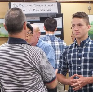 Commack High School inventors get a professional earful.